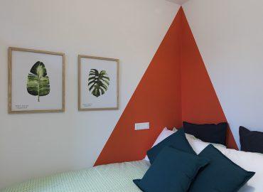 Dettaglio letto della camera Arancione B&B a Firenze La Marmora 39
