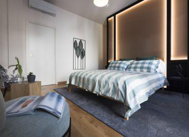 Letto e poltrona camera verde B&B Firenze per famiglie La Marmora 39