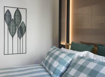 Dettaglio letto camera verde del B&B Firenze per famiglie La Marmora 39
